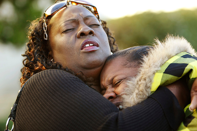 Monquasha Peter, right, 19, cousin of rape suspect Marcelles Peter, 17, is hugged by family friend Deborah Hamilton-Turnipseed, as they claim his innocence outside of a Richmond, Calif., courthouse, Thursday, Oct. 29, 2009. Four teens were charged, including Peter, in the alleged gang rape and beating of a 15-year-old girl outside her high school homecoming dance in Richmond.  (AP Photo/Paul Sakuma)