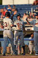 Connecticut Tigers outfielder Ross Kivett (55 - center) high fives outfielder Michael Gerber (13) after hitting a home run with third baseman Joey Pankake (46) to the right during a game against the Batavia Muckdogs on July 21, 2014 at Dwyer Stadium in Batavia, New York.  Connecticut defeated Batavia 12-3.  (Mike Janes/Four Seam Images)