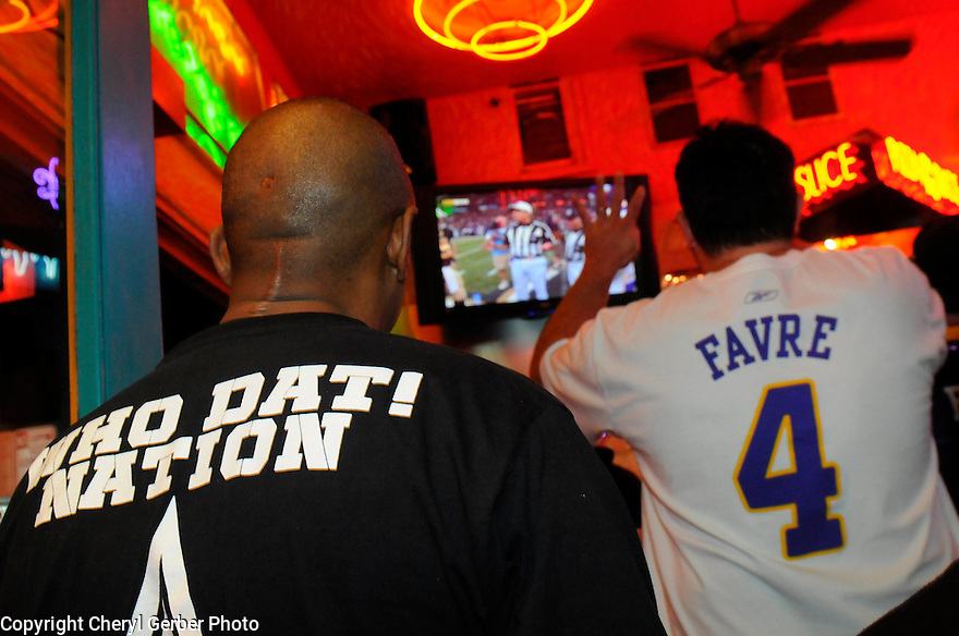 A New Orleans Saints fan and a Minnesota Vikings fan watch the NFC Championship game go into overtime,  New Orleans, Sunday, Jan. 24, 2010. The Saints won with a field goal..(AP Photo/Cheryl Gerber)