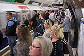 Crowded platform at Charing Cross tube station at rush hour London.
