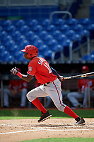 Washington Nationals Caldioli Sanfler (11) follows through on a swing during a Florida Instructional League game against the Miami Marlins on September 26, 2018 at the Marlins Park in Miami, Florida.  (Mike Janes/Four Seam Images)