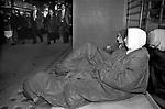 Teenage girls sleeping rough in a shop doorway The Strand central London, people walk past. 1990s. UK