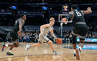 WASHINGTON, DC - FEBRUARY 19: Emmitt Holt #15 of Providence closes in on Mac McClung #2 of Georgetown during a game between Providence and Georgetown at Capital One Arena on February 19, 2020 in Washington, DC.