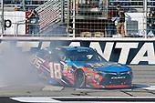 2017 NASCAR XFINITY Series - Rinnai 250<br /> Atlanta Motor Speedway, Hampton, GA USA<br /> Saturday 4 March 2017<br /> Kyle Busch, NOS Energy Drink Toyota Camry celebrates his win with a burnout<br /> World Copyright: Nigel Kinrade/LAT Images<br /> ref: Digital Image 17ATL1nk05571