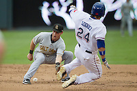 Salt Lake Bees shortstop Andrew Romine (7) attempts to catch the ball during a steal attempt by Round Rock Express baserunner Jim Adduci (24) in the Pacific Coast League baseball game on August 10, 2013 at the Dell Diamond in Round Rock, Texas. Round Rock defeated Salt Lake 9-6. (Andrew Woolley/Four Seam Images)
