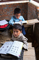 Nepal, Gorkha, Sindhulpalchowk. Area that was heavily damaged in the earthquake and in the process of being rebuilt. Shree Sarba Sudhar Primary School. A school being built with the help of NYF, Nepal Youth Foundation funding. Children are already attending the school.