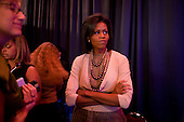 Denver, Colorado<br /> August 26, 2008<br /> <br /> Michelle Obama watches Senator Hillary Clinton speak back stage at the Sheraton Hotel before addressing Emily's List Gala reception. Sen. Clinton praised Michelle and her husband Barack Obama.