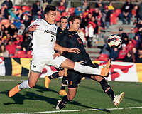 COLLEGE PARK, MD - NOVEMBER 03: Derick Broche #7 of Michigan and Brett St. Martin #12 of Maryland in action during a game between Michigan and Maryland at Ludwig Field on November 03, 2019 in College Park, Maryland.