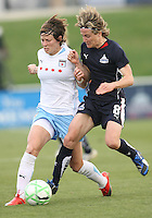 Sonia Bompastor of the Washington Freedom  takes the ball from Megan Rapinoe of the Chicago Red Stars during a WPS match at Maryland Soccerplex on April 11 2009, in Boyd's, Maryland.  The game ended in a 1-1 tie.