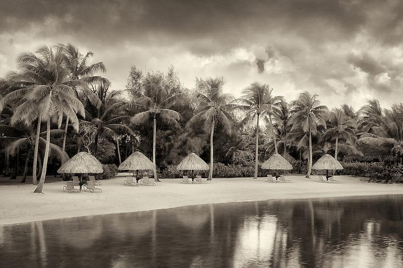 Unbrellas and chairs on lagoon beach. Bora Bora. French Polynesia.