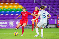 ORLANDO, FL - FEBRUARY 21: Evelyne Viens #9 of the CANWNT kicks the ball during a game between Argentina and Canada at Exploria Stadium on February 21, 2021 in Orlando, Florida.