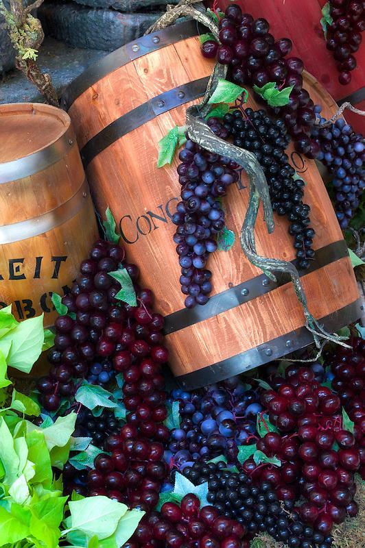 Wine barrel and grape display.