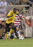COLUMBUS, OHIO - SEPTEMBER 11, 2012:  Jose Torres (16) of the USA MNT misses a tackle on JeVaughan Watson (15) of  Jamaica during a CONCACAF 2014 World Cup qualifying  match at Crew Stadium, in Columbus, Ohio on September 11. USA won 1-0.