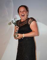 France, Paris, 03.06.2014. Tennis, French Open, Roland Garros, ITF Champions diner, World Champion Wheelchair tennis Aniek van Koot (NED) receives the trophy<br /> Photo:Tennisimages/Henk Koster