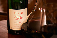 Bottle on a table with wine glasses and decanter in the wine bar Le Cafe du Passage in Paris. La Jasse 2002. Domaine La Jasse Castel. Montpeyroux. Languedoc. Wine aerating in a carafe. France. Europe.