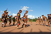 Xingu Indigenous Park, Mato Grosso State, Brazil. Aldeia Kuikuro - central village. Festival of Beija Flor; the whole village joins in the dance, elders, warriors and boys.