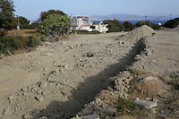 Pictured: Mounts of rubble left at the second site where a search took place in Kos, Greece. Monday 17 October 2016<br />Re: The search for missing Ben Needham led by South Yorkshire Police has concluded on the Greek island of Kos.<br />Ben, from Sheffield, was 21 months old when he disappeared on 24 July 1991 during a family holiday.<br />Digging took place around the farmhouse where Ben Needham was last seen and at a new site after a fresh line of inquiry suggested he could have been crushed by a digger.