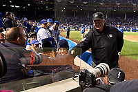Umpire Joe West shakes hands with Cleveland Indians legend Joe Thome (left) in between innings in the fifth inning during Game 5 of the Major League Baseball World Series against the Chicago Cubs on October 30, 2016 at Wrigley Field in Chicago, Illinois.  Thome son is at center.  (Mike Janes/Four Seam Images)