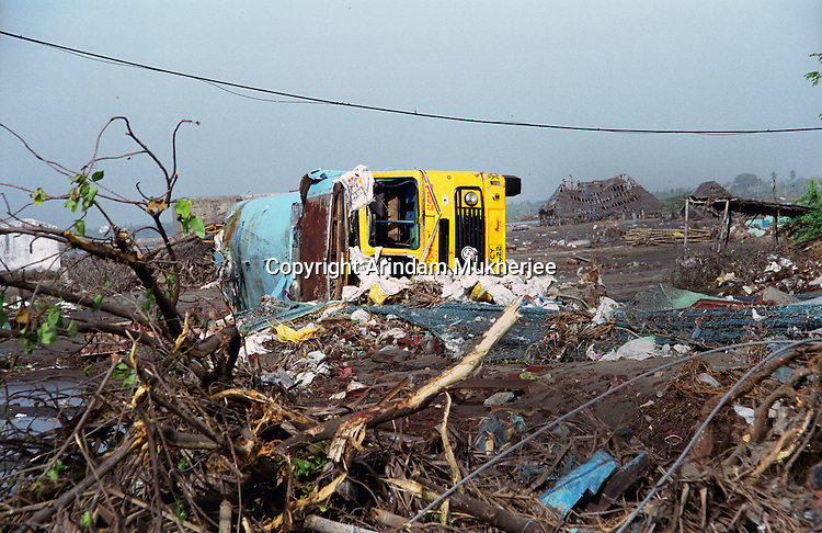 Fallen trees and over-turned trucks at Akarapettai village in Nagapattinam district,Tamil Nadu.India.