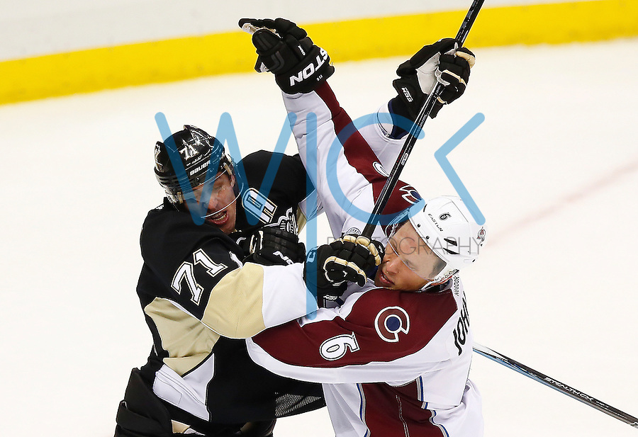 Evgeni Malkin #71 of the Pittsburgh Penguins tussles with Erik Johnson #6 of the Colorado Avalanche in the second period during the game at Consol Energy Center on November 19, 2015. (Photo by Jared Wickerham/DKPittsburghSports)