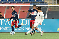 FOXBOROUGH, MA - OCTOBER 09: Blaine Ferri #8 of Fort Lauderdale CF pushes the ball forward as Maciel #6 of New England Revolution II comes in to tackle during a game between Fort Lauderdale CF and New England Revolution II at Gillette Stadium on October 09, 2020 in Foxborough, Massachusetts.