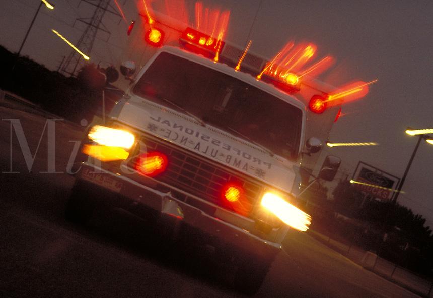Emergency, Ambulance, Trauma, special effect illustrating speed, urgency, streaked lights, vehicle, transportation, medicine, medical.