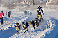Musher Brent Sass mushes down the Chena River at the start of the 2008 Yukon Quest in Fairbanks, Alaska.