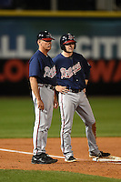 Gwinnett Braves manager Brian Snitker (4) and second baseman Philip Gosselin (8) during a game against the Buffalo Bisons on May 13, 2014 at Coca-Cola Field in Buffalo, New  York.  Gwinnett defeated Buffalo 3-2.  (Mike Janes/Four Seam Images)