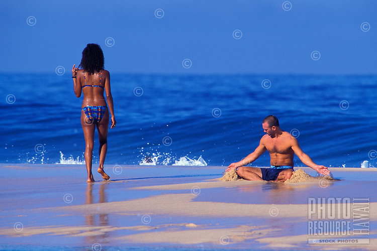 Young couple enjoying themselves at the beach