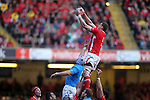 Ian Evans beats Cornelius Van Zyl to the lineout ball..2012 RBS 6 Nations.Wales v Italy.Millennium Stadium..10.03.12.Credit: STEVE POPE-Sportingwales