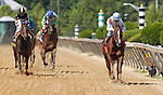May 18, 2012 Agave Kiss (#7), Ramon Dominguez up, wins the 27th running of the Ms. Preakness Pink Warrior Stakes at Pimlico Race Course in Baltimore, Maryland. photo by Joan Fairman Kanes