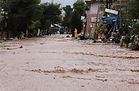 Pictured: The main road is still flooded.<br /> Re: People have died, some still missing and severe damage caused by heavy rain and flash flooding in the area of Mandra, near Athens, Greece. Thursday 16 November 2017
