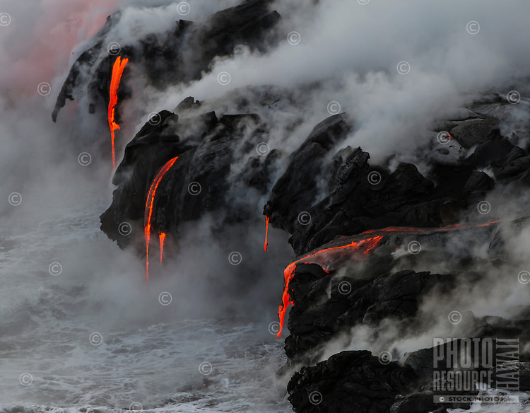 Lava flows into the ocean, creating dynamic formations of many shapes along the unstable cliffs by Hawai'i Volcanoes National Park and the Kalapana border, Big Island.
