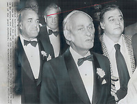 Security guards and businessmen surround Quebec Premier Rene Levesque as he enters Economic Club of New York dinner last night. At left are club chairman James Davant and David Rockefeller, chairman of Chase Manhattan Bank. Levesque said a separate Quebec - which he said was inevitable - would welcome foreign investment in all but few key sectors such as banking communications. 1977<br /> <br /> 1977<br /> <br /> PHOTO :  Doug Griffin - Toronto Star Archives - AQP
