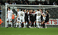 Pictured: A scuffle breaks out between Swansea and Barnsley players after the foul of Garry Monk of Swansea against Mounir El Haimour of Barnsley while waiting for Barnsley to take a penalty<br /> Re: Coca Cola Championship, Swansea City FC v Barnsley at the Liberty Stadium. Swansea, south Wales, Tuesday 09 December 2008.<br /> Picture by D Legakis Photography / Athena Picture Agency, Swansea 07815441513