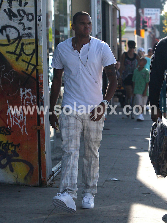 **ALL ROUND PICTURES FROM SOLARPIX.COM**.**WORLDWIDE SYNDICATION RIGHTS EXCEPT FOR USA, AUSTRALIA & GERMANY**.Chris Brown and Rihanna were spotted shopping together on Melrose Ave in West Hollywood, CA, USA. 21st August 2008..This pic: Chris Brown..JOB REF: 7081 LAS       DATE: 21_08_2008.**MUST CREDIT SOLARPIX.COM OR DOUBLE FEE WILL BE CHARGED* *UNDER NO CIRCUMSTANCES IS THIS IMAGE TO BE REPRODUCED FOR ANY ONLINE EDITION WITHOUT PRIOR PERMISSION*