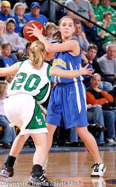 BROOKINGS, SD - March 14th, 2009 : Megan Jordre of Aberdeen Central looks past Linsey Peterson of Pierre as she awaits her team to get into position during their game Saturday evening in the 2009 State AA Girls Basketball Tournament in Frost Arena on the campus of South Dakota State University in Brookings, SD. (Photo By Ty Carlson/Inertia)
