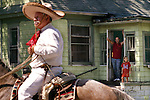 This year's Mexican Independence Day parade brought a few curious onlookers out of their houses, including Robert McGlothlin and daughter Crystal, 6. McGlothlin says that since he is from California, the event was a familiar sight. After the parade a few hundred people--not all Hispanic--attended a downtown celebration. The September 16 holiday commemorates the beginning of Mexico's revolution against Spain in 1810.