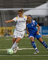 Los Angeles Sol midfielder Camille Abily (20) controls ball as Boston Breakers midfielder-forward Angela Hucles (16) defends. The Boston Breakers defeated Los Angeles Sol, 2-1, at Harvard Stadium on May 2, 2009.