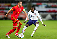 SWANSEA, WALES - NOVEMBER 12: Chris Gunter #2 of Wales attempts to move around Timothy Weah #23 of the United States meets during a game between Wales and USMNT at Liberty Stadium on November 12, 2020 in Swansea, Wales.