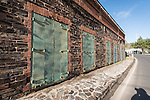 Iron doors and stone and brick façade of the Gamble Block, built in 1852, is one of the largest stone store buildings remaining in the Gold Country, Big Oak Flat, Califl.