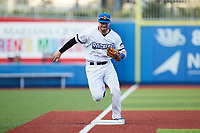 Stuart Levy (8) of the High Point Rockers runs towards third base after fielding a ground ball during the game against the Lexington Legends at Truist Point on June 16, 2021, in High Point, North Carolina. The Legends defeated the Rockers 2-1. (Brian Westerholt/Four Seam Images)