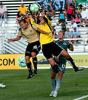 FC Gold Pride forward Tiffeny Milbrett (15) and Saint Louis Athletica goalkeeper Hope Solo (1) during a WPS match at Anheuser-Busch Soccer Park, in St. Louis, MO, July 26, 2009.  The match ended in a 1-1 tie.