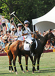 (L) Prince Harry competing at the 3rd Annual Veuve Clicquot Polo Classic on Governors Island on June 27, 2010.