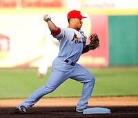 Kolten Wong (4) of the Springfield Cardinals turns a double play during a game against the Northwest Arkansas Naturals at Hammons Field on June 14, 2012 in Springfield, Missouri. (David Welker/Four Seam Images).