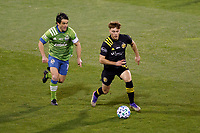 COLUMBUS, OH - DECEMBER 12: Aidan Morris #21 of Columbus Crew battles for the ball against Nicolas Lodeiro #10 of Seattle Sounders FC during a game between Seattle Sounders FC and Columbus Crew at MAPFRE Stadium on December 12, 2020 in Columbus, Ohio.