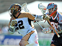 24 August 2008: Rochester Rattlers' Midfielder Casey Powell is persued by Denver Outlaws' Midfielder Nate Watkins during the Championship Game of the Major League Lacrosse Championship Weekend at Harvard Stadium in Boston, MA. The Rattles defeated the Outlaws 16-6 to take the league honor for the 2008 season...Mandatory Photo Credit: Ed Wolfstein Photo