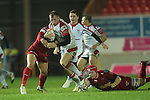 Ulster number 8 skips through the tackle of Kieran Murphy..Celtic League.Scarlets v Ulster.Parc y Scarlets.02.12.12..©Steve Pope