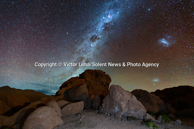 "Pictured: The night sky over the Atacama Desert in Chile<br /> <br /> Photographs show incredible landscapes below a sky illuminated by stars. Away from cities and using long-exposure shots captures what cannot be seen with the naked eye of the night sky. <br /> <br /> The photos were taken across South America by landscape photographer Victor Lima. Mr Lima, 45, said: ""It is necessary to have a deep connection with nature to be able to understand a landscape you can't see with your own eyes."" SEE OUR COPY FOR ME DETAILS<br /> <br /> Please byline: Victor Lima/Solent News<br /> <br /> © Victor Lima/Solent News & Photo Agency<br /> UK +44 (0) 2380 458800"