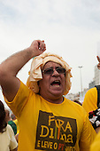 A man wearing a 'Fora Dilma' (Dilma [Rousseff] Out) t-shirt with his fist clenched. Rio de Janeiro, Brazil, 15th March 2015. Popular demonstration against the President, Dilma Rousseff in Copacabana. Photo © Sue Cunningham sue@scphotographic.com.